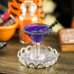 Halloween Black Magic Martini with Black Licorice Twist on Tray