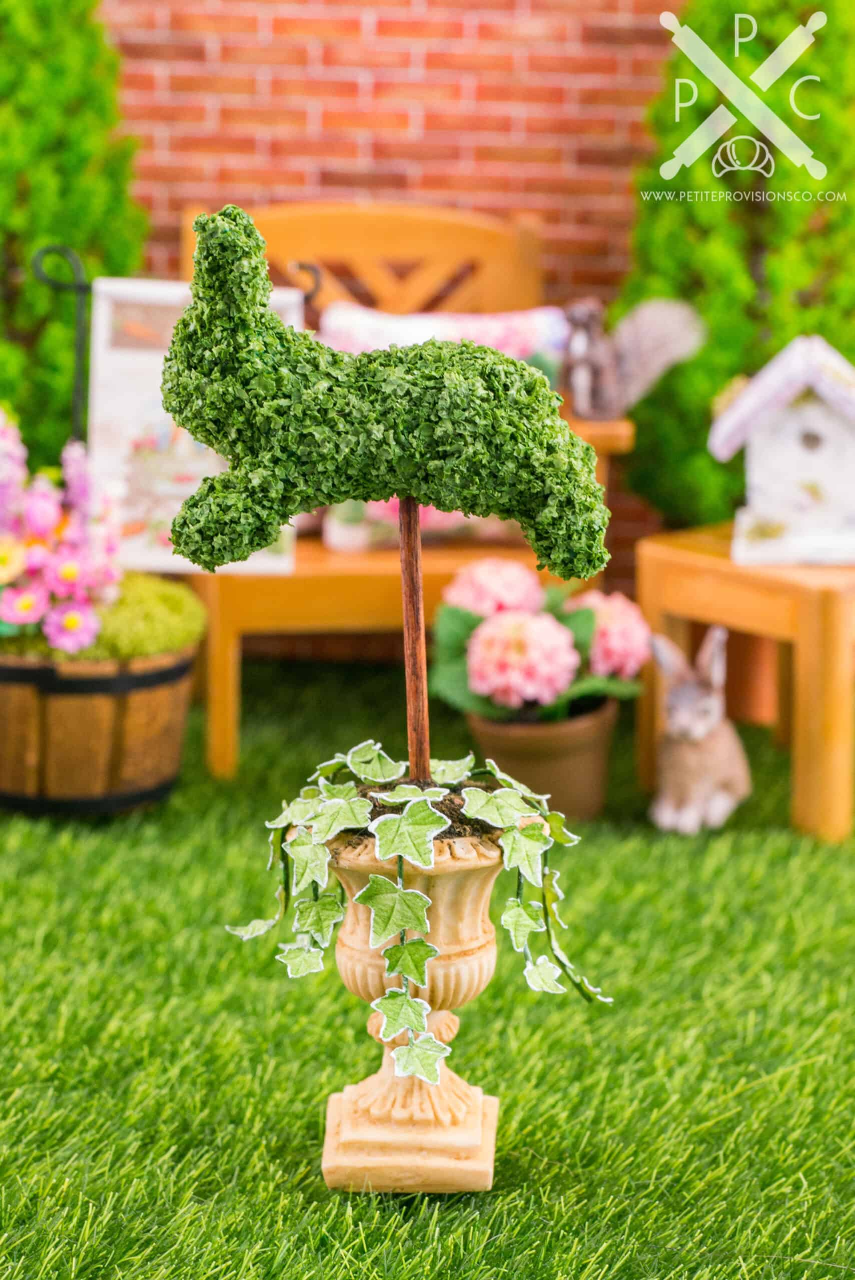 A handmade leaping bunny topiary in one inch scale by The Petite Provisions Co.