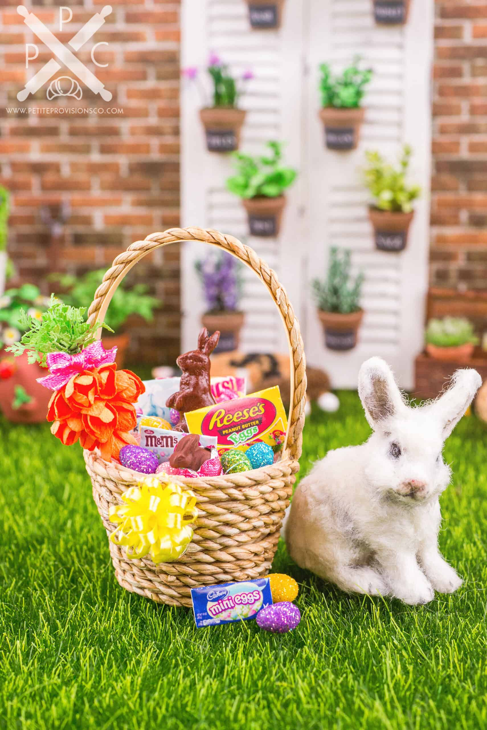 A one inch scale dollhouse miniature Easter basket with Easter candies and chocolate bunnies