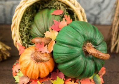 Plentiful Harvest Basket of Pumpkins and Autumn Leaves