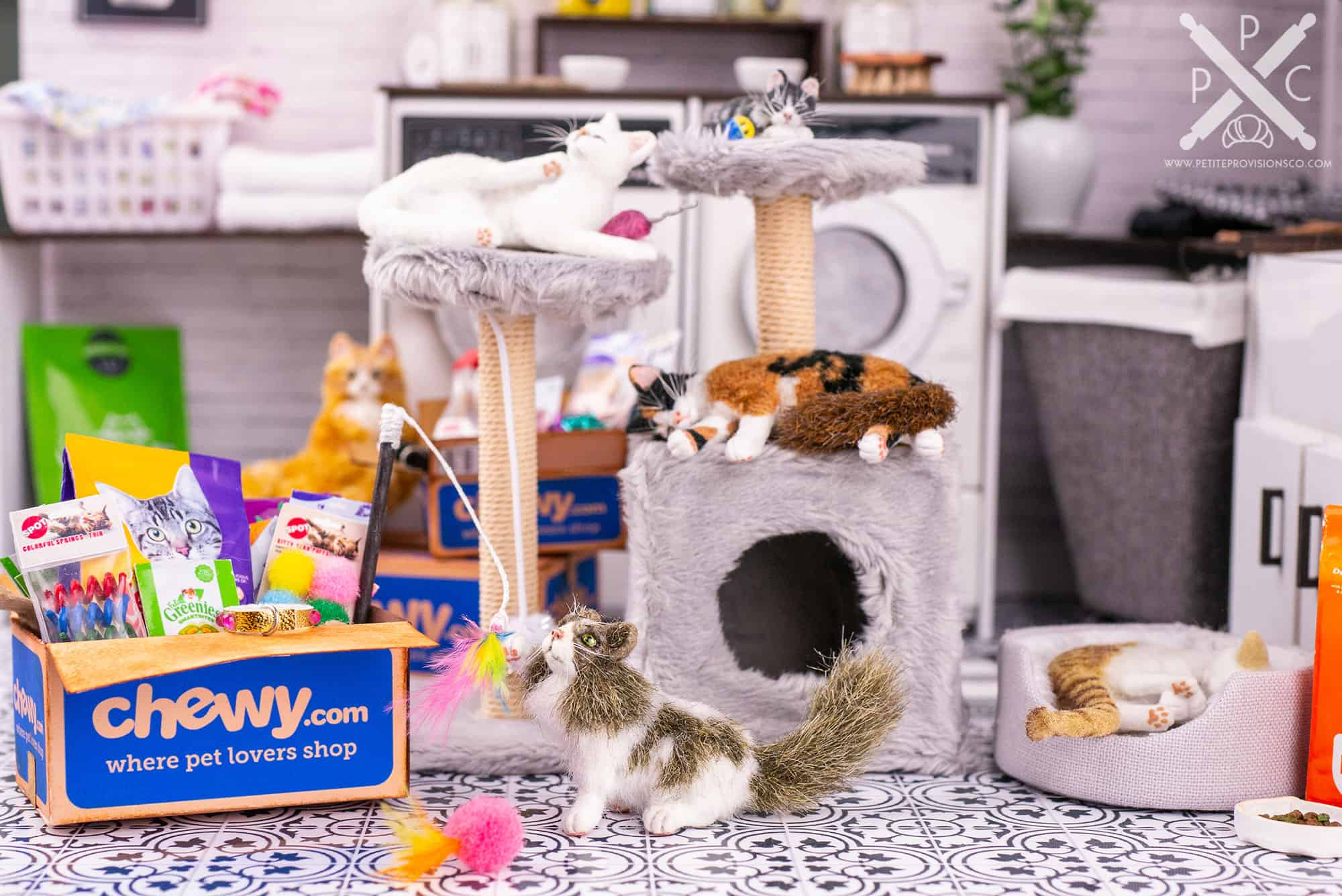 Dollhouse miniature cats and kittens with shipping boxes of toys and food from Chewy in a one inch scale scene by Erika Pitera, The Petite Provisions Co.