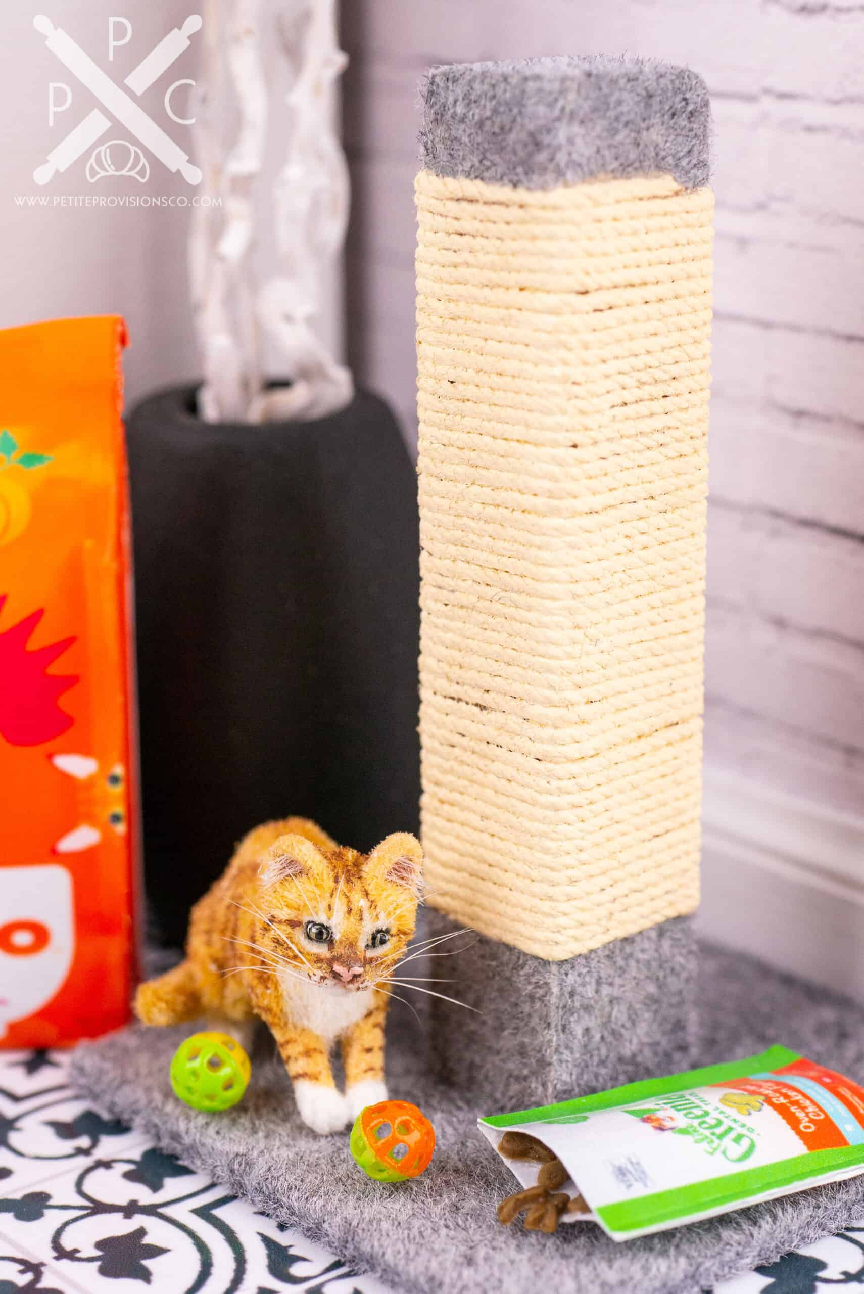 One inch scale orange tabby kitten playing with cat toys in a dollhouse miniature scene by Erika Pitera, The Petite Provisions Co.