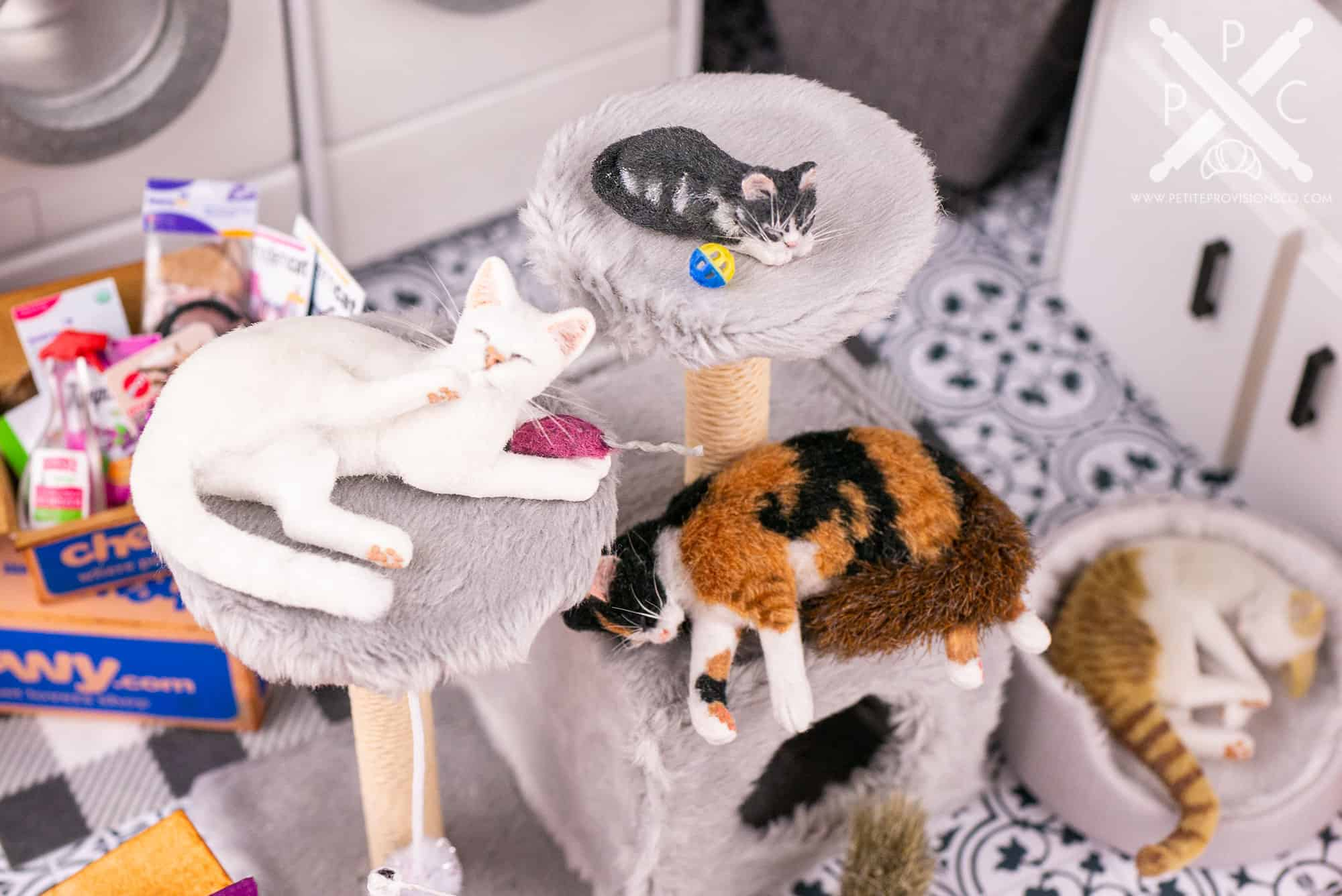 1/12 scale cats and kittens sleeping on a handmade cat tower with scratching posts in a dollhouse miniature scene by Erika Pitera, The Petite Provisions Co.