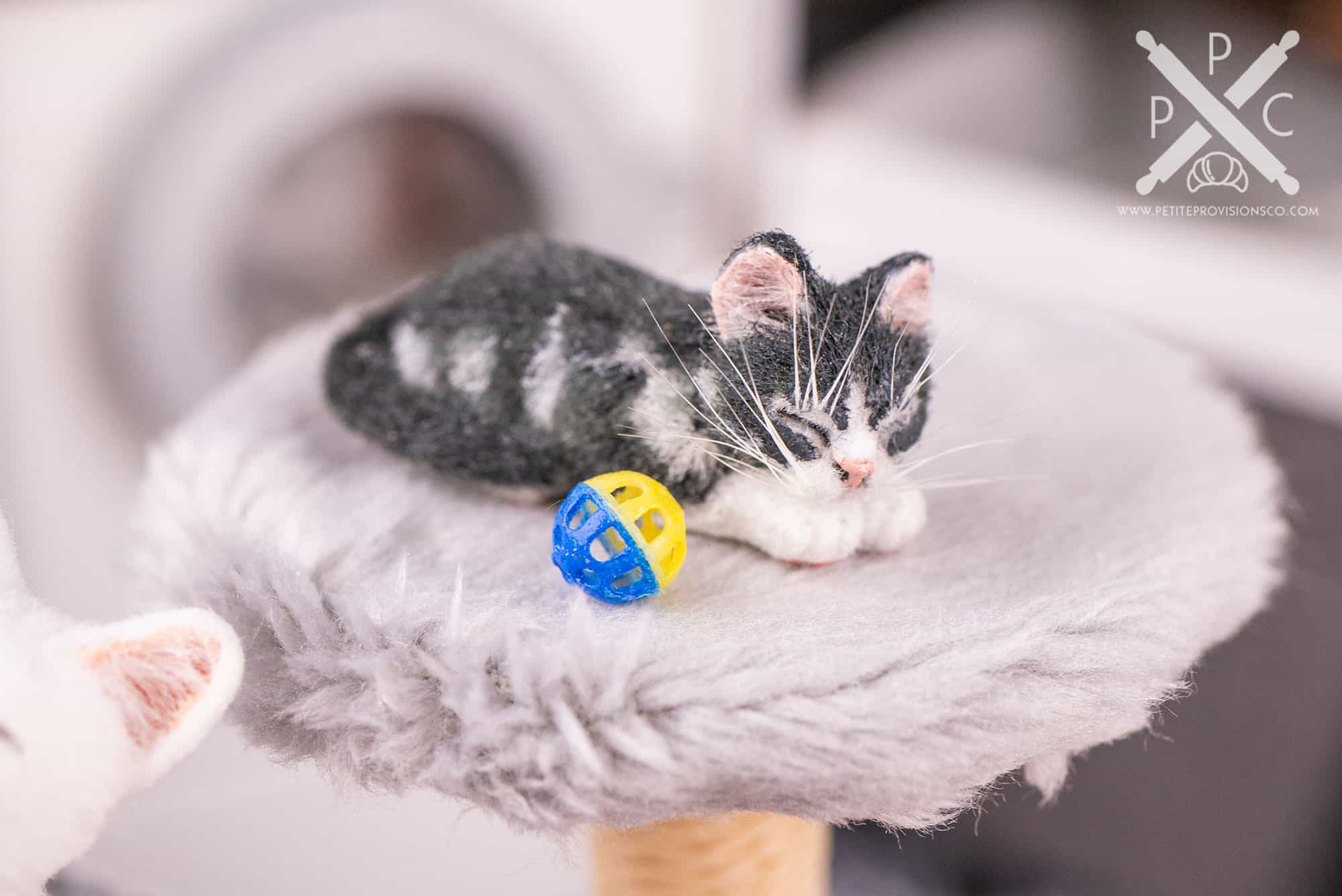 1/12 scale kitten sleeping next to a cat toy in a dollhouse miniature scene by Erika Pitera, The Petite Provisions Co.