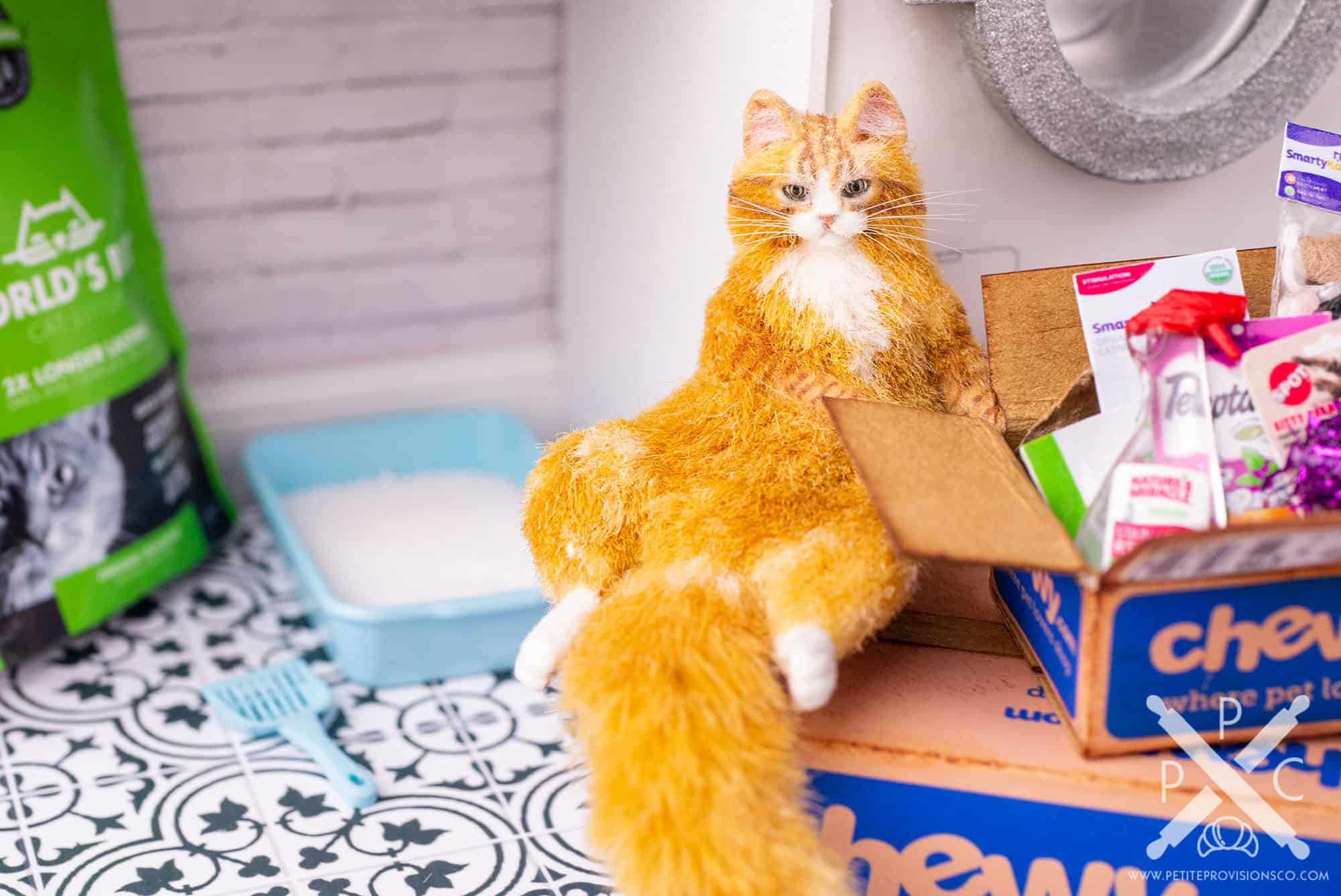 Dollhouse miniature fat orange tabby with a litter box in an one inch scale scene by Erika Pitera, The Petite Provisions Co.