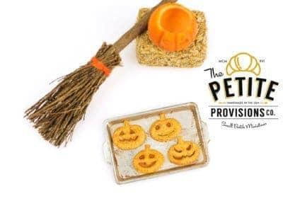 Jack-O-Lantern Pumpkin Hand Pies on Baking Sheet