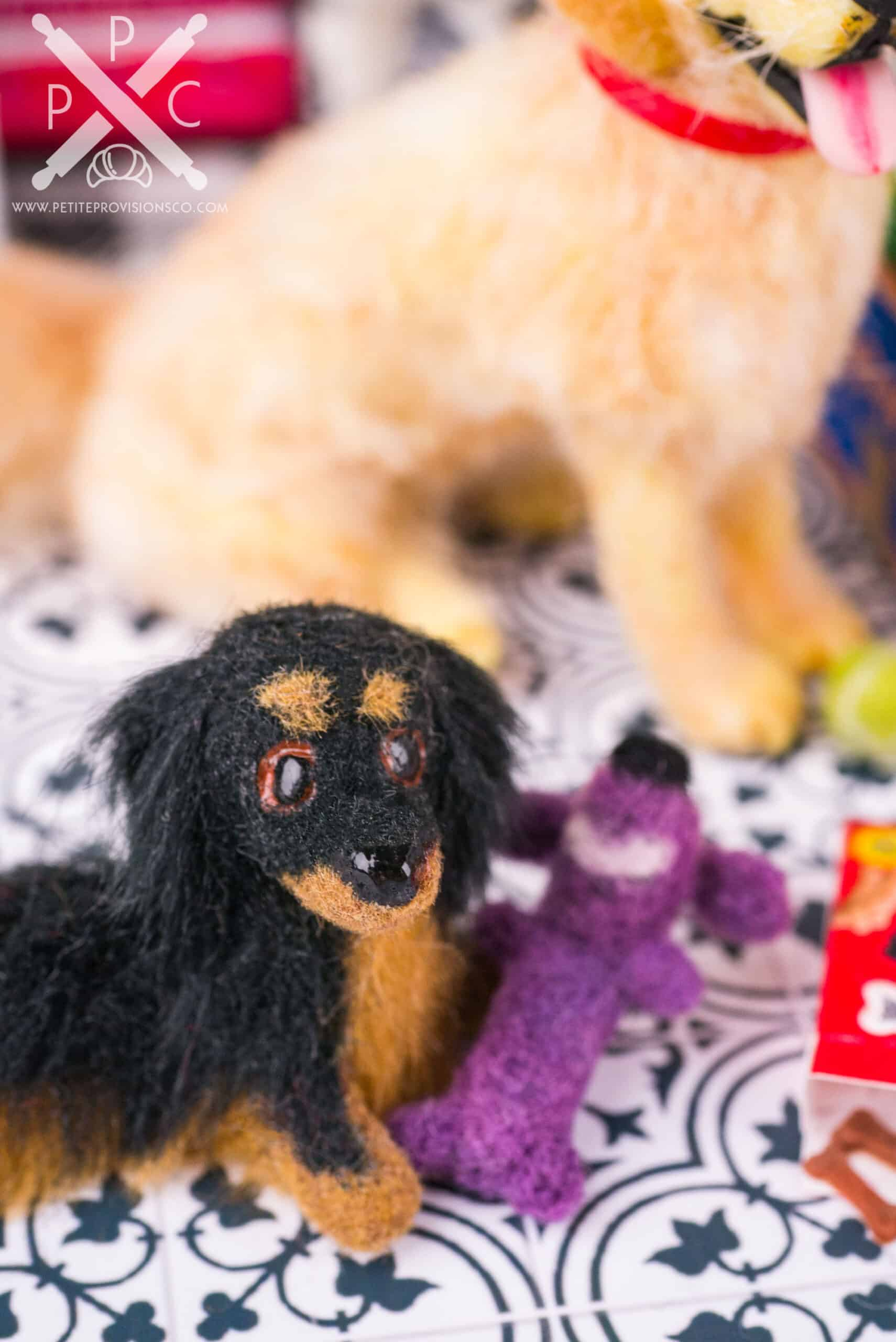 One inch scale needle felted dog toy in a dollhouse miniature scene by Erika Pitera, The Petite Provisions Co.