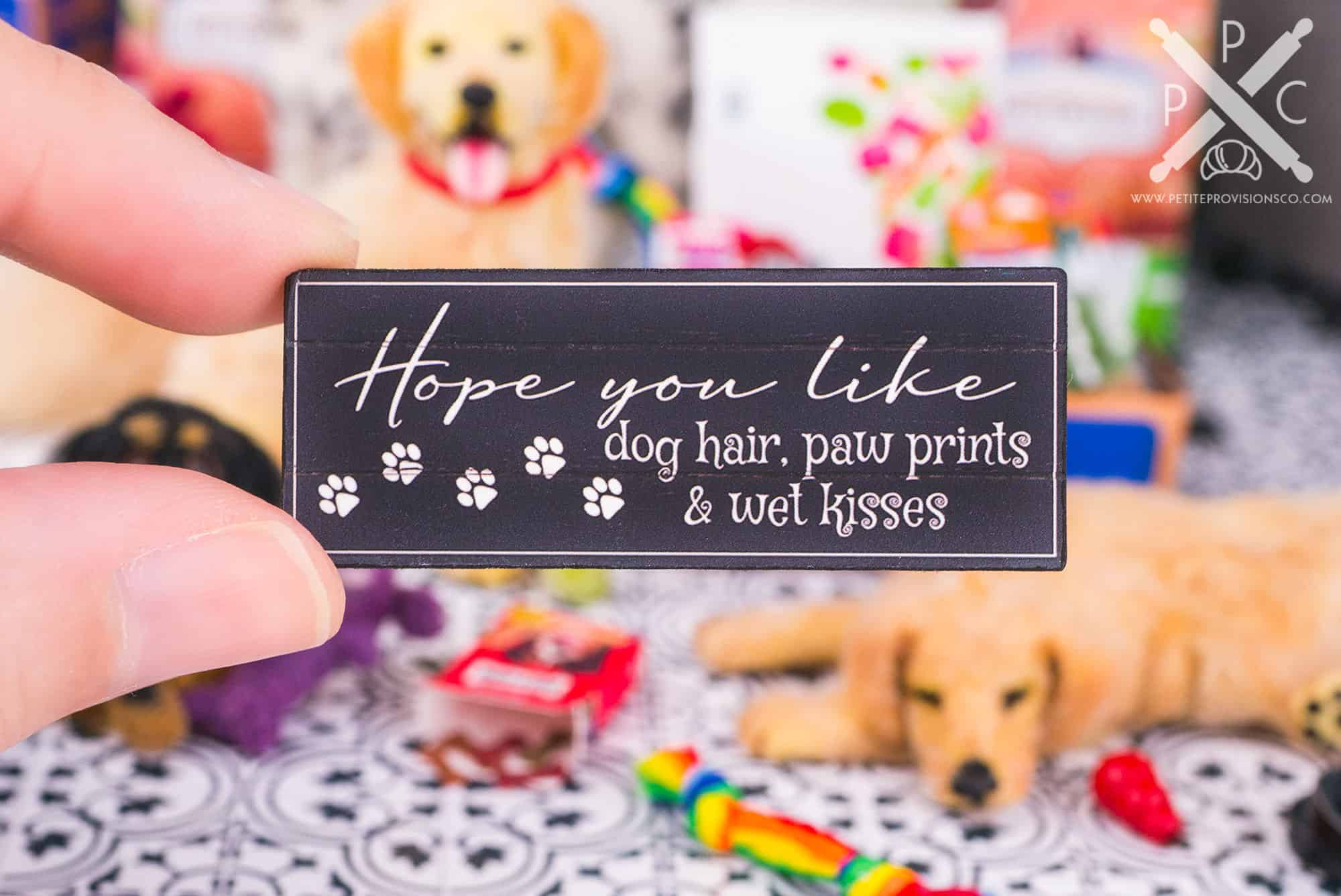 Handmade dollhouse miniature sign for dog lovers in a one inch scale scene by Erika Pitera, The Petite Provisions Co.