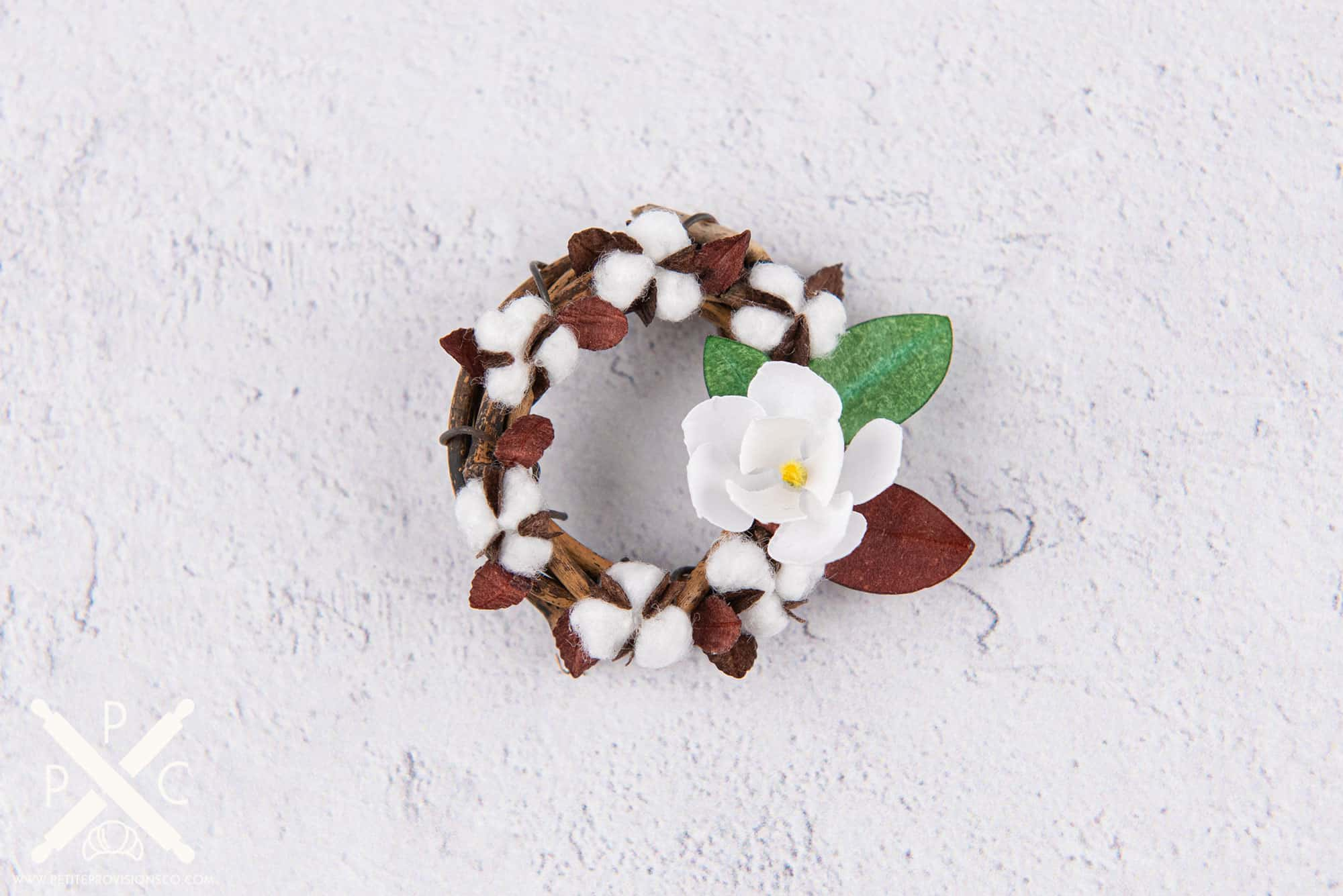 Make a miniature grapevine wreath with your natural cotton bolls