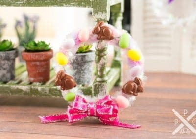 Purple and Pink Easter Wreath with Eggs and Chocolate Bunnies