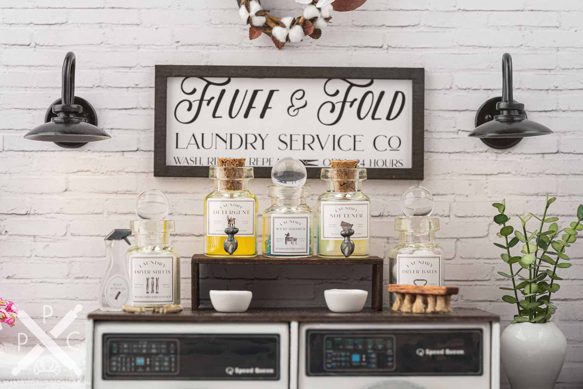 Barn lights and miniature laundry products in a one-inch scale laundry room scene with farmhouse decor
