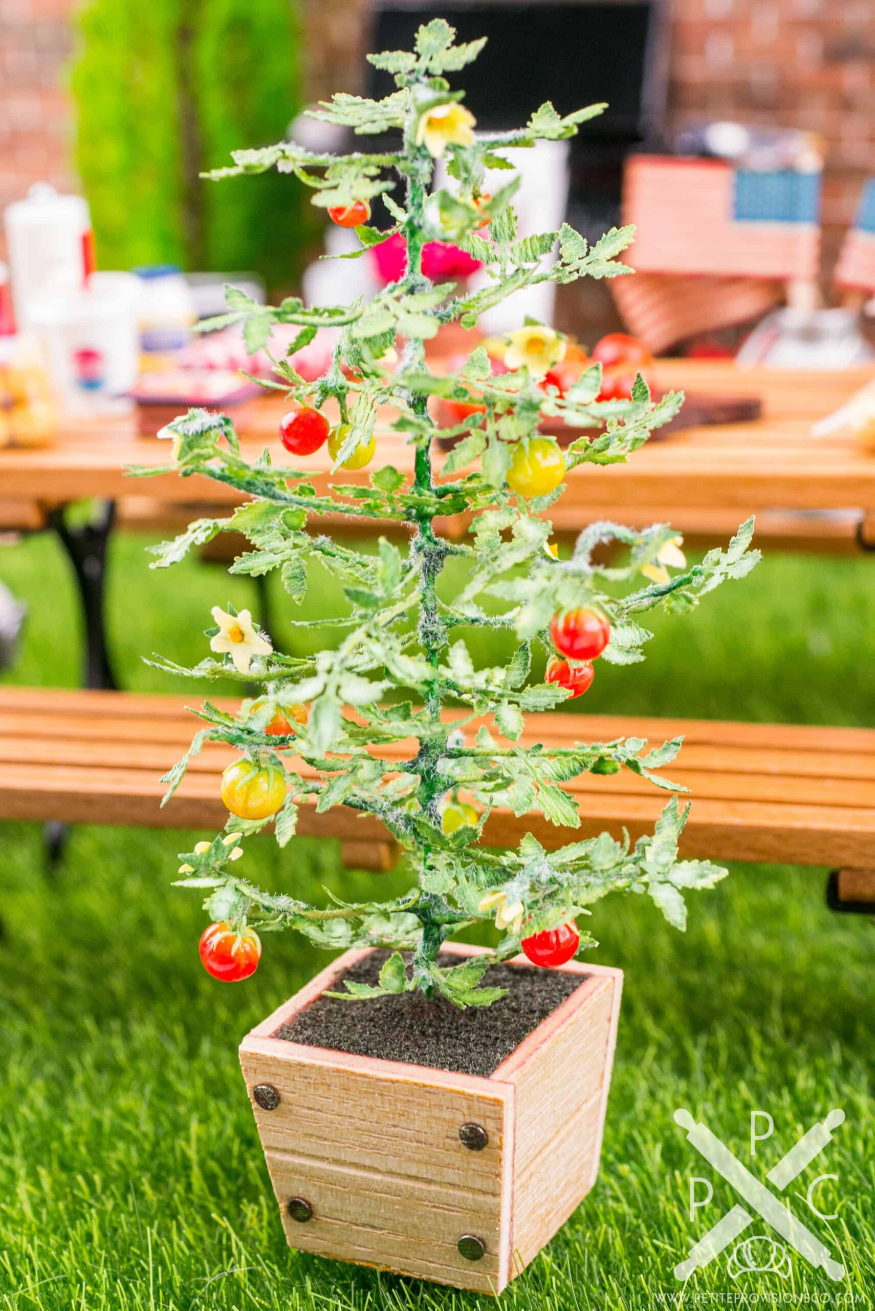 Dollhouse miniature tomato plant in wooden planter