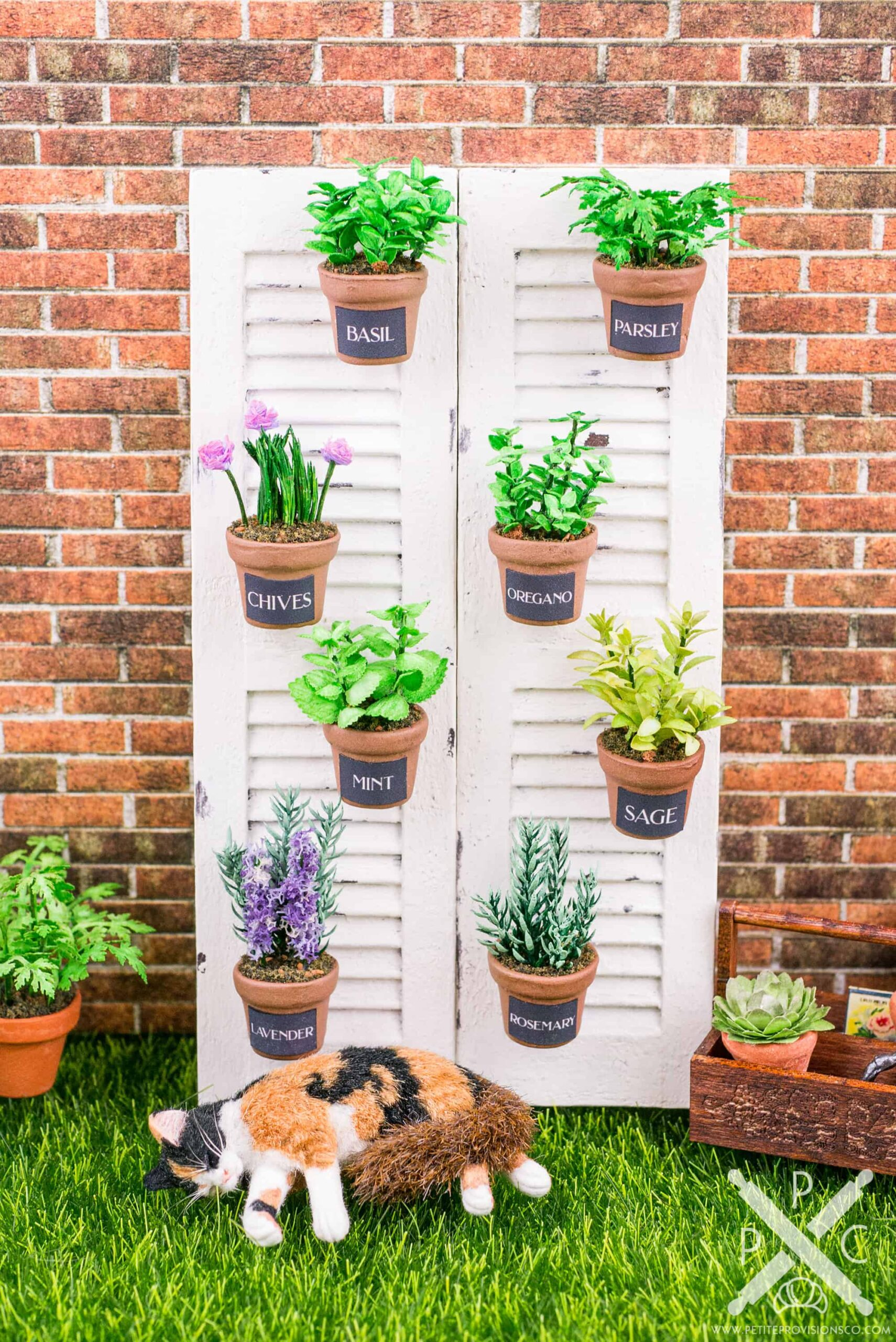 Dollhouse miniature vertical herb garden on repurposed shutters by miniature artisan Erika Pitera of The Petite Provisions Co.