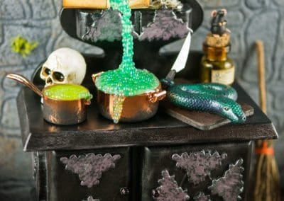 Haunting Halloween Witch's Stove with Floating Potion Bottle